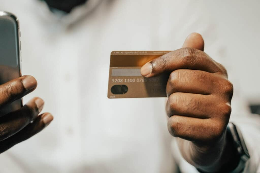 Man holding phone and credit card